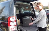 Image of a meals on wheels volunteer with car
