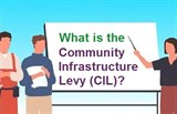 What is the Community Infrastructure Levy (CIL)? Three people around a white board.