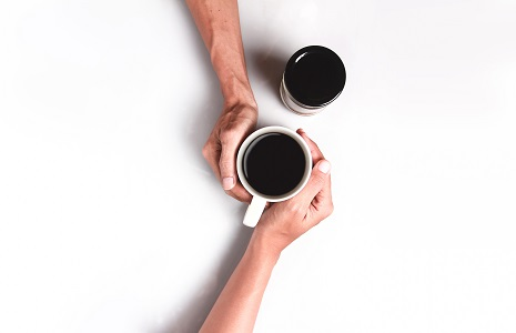 Two People Holding White Mug Filled With Coffee.jpg